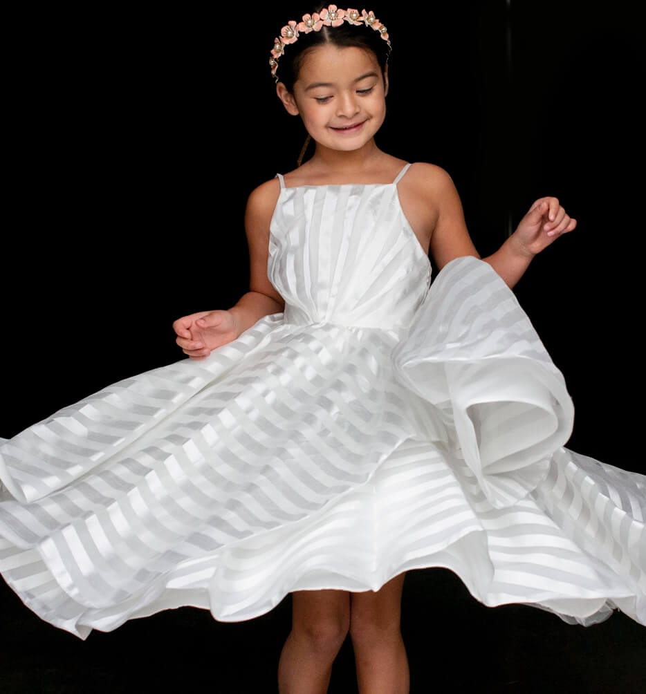 Flower girl in a white dress
